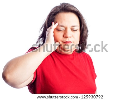 Hispanic woman in red shirt holding her hand to her head with eyes closed