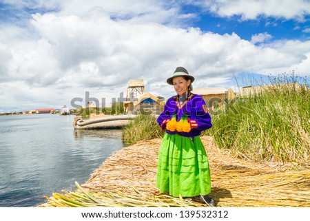 Hispanic woman in traditional indigenous clothing, Puno, Uros islands, Peru - stock photo