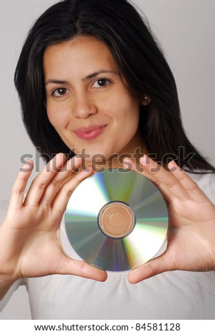 Hispanic woman portrait holding a compact disc. - stock photo