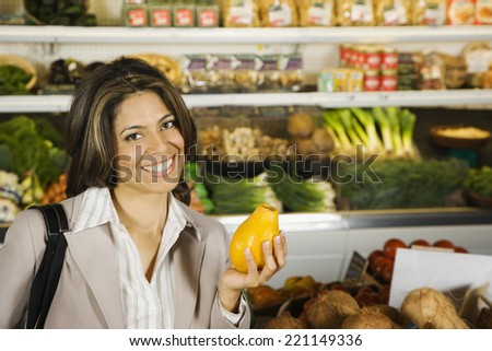 Hispanic woman shopping in grocery store - stock photo