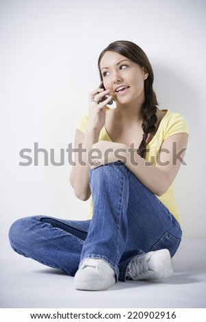 Hispanic woman talking on cell phone - stock photo