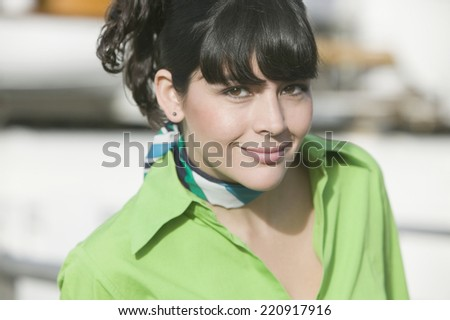 Hispanic woman wearing scarf around neck - stock photo