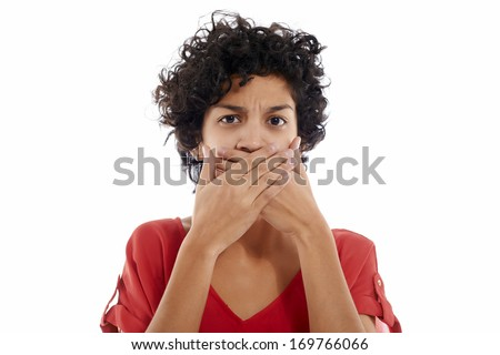 hispanic woman with hands covering mouth, speachless and angry, looking at camera
