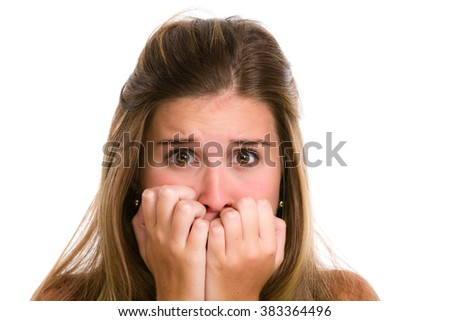 Hispanic young woman with fear expression and hands on face. Studio shot of face expressions female series - stock photo