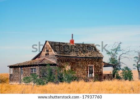Historic abandoned farmhouse - stock photo