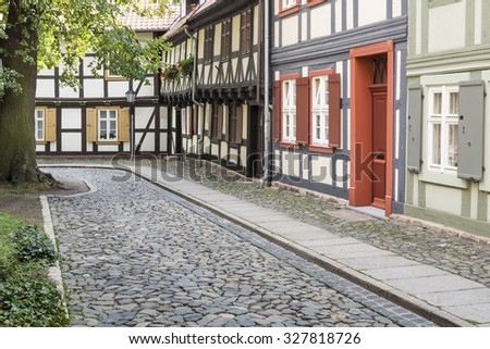 Historic alleyway with half-timbered houses in the town of Wernigerode, Germany - stock photo