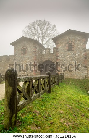 Historic Ancient Rome Castle in a Foggy Misty Day and Wooden Fence - stock photo