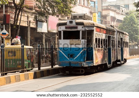 Historic and heritage tram of Calcutta running through part of the old town. - stock photo