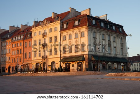 Historic apartment buildings on the Krakowskie Przedmiescie street at sunrise, next to the Old Town of Warsaw, Poland.