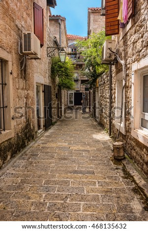 Historic architecture, narrow stone walkways, and decorative balconies in Kotor, Montenegro.