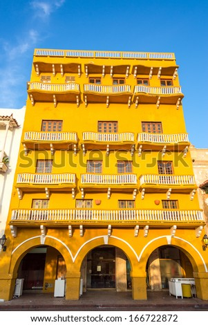 Historic architecture of a yellow colonial building in the historic center of Cartagena, Colombia - stock photo