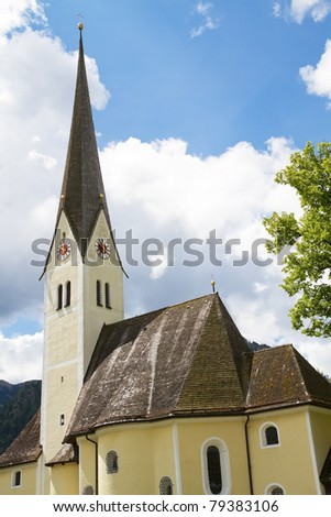 Historic Bavarian church with clouded sky