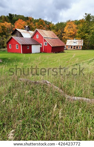 Historic Bufka Farm surrounded by autumn colors. Built by Charles Bufka in 1880, it is part of the Sleeping Bear Dunes historic district - stock photo