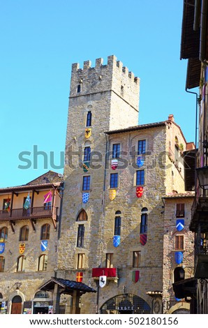 historic building districts crests Arezzo in Tuscany - Italy