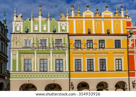 "Historic building on Market Square in Zamosc, Poland. Zamosc - example of a Renaissance town in Central Europe, designed with Italian theories of ""ideal town"", UNESCO World Heritage List. - stock photo"