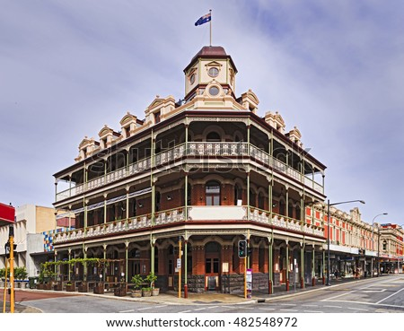 Historic buildings in the centre of Fremantle town near Perth of Western Australia. Corner of town streets with accommodation and pub and patrons.