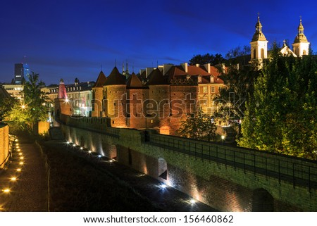 Historic buildings of the old town in Warsaw.Barbican - stock photo