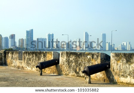 historic cannons fortress The Wall Cartagena Colombia South America  view Bocagrande beach resort - stock photo