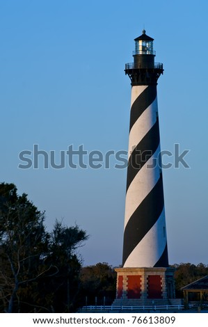 historic cape hatteras lighthouse, with warm early morning light against clear blue sky, winter 2006