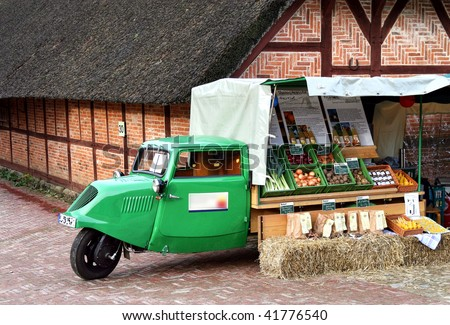 Historic car with a vegetable shop, near Hamburg in the Lueneburg Heath, Germany (part of a special Christmas exhibition)