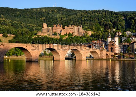 Historic castle and the Old Bridge in Heidelberg, Germany, shot in warm summer evening sunlight - stock photo