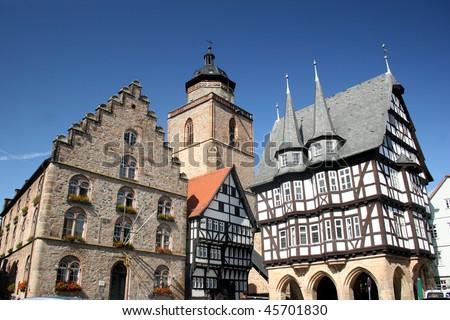 Historic center of the german city Alsfeld with Weinhaus, Church Walpurgiskirche and town hall - stock photo