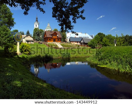 historic church of St Anne's Basilica and Shrine of Our Lady of Kodeniu the Bug river in Poland, view from the Calvary - stock photo