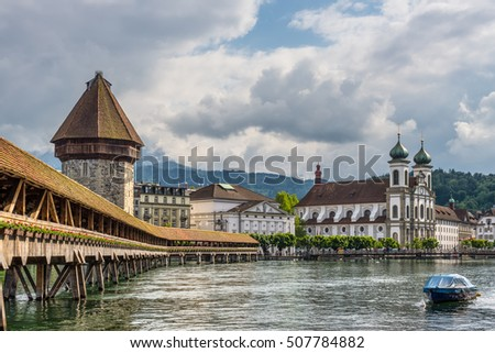 Historic city center of Lucerne with famous Chapel Bridge and Jesuit Church on the river Reuss in Lucerne's old town, Canton of Lucerne, Switzerland