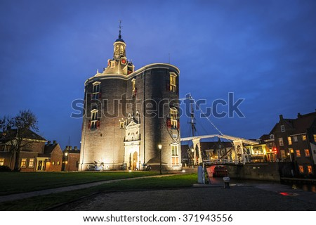 Historic city gate Drommedaris in the evening light in  Enkhuizen, The Netherlands - stock photo