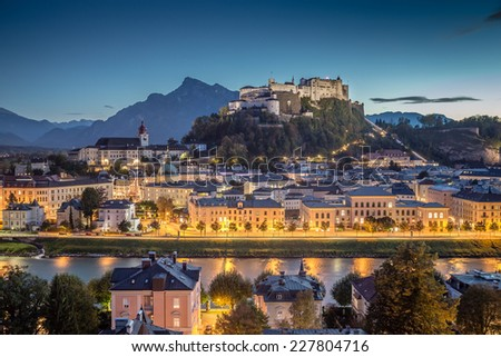 Historic city of Salzburg with Hohensalzburg Fortress at dusk, Salzburger Land, Austria - stock photo
