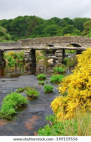 Historic clapper bridge in Dartmoor National Park, Devon, England - stock photo