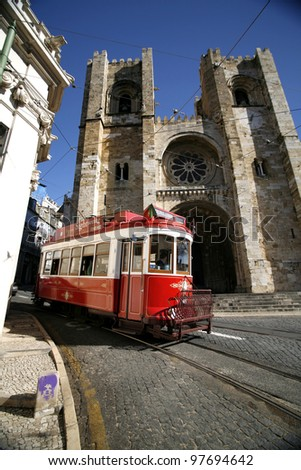 historic classic red tram of Lisbon built partially of wood navi