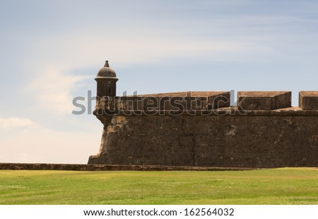 Historic colonial El Morro fortress with a lookout tower in San Juan, Puerto Rico - stock photo