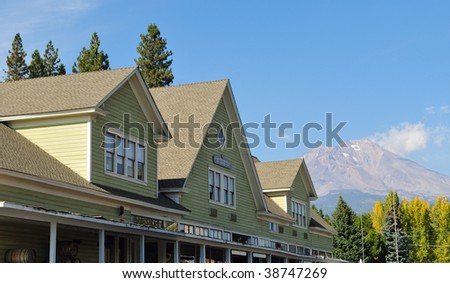 Historic company store building in McCloud, California with Mount Shasta in the background. - stock photo