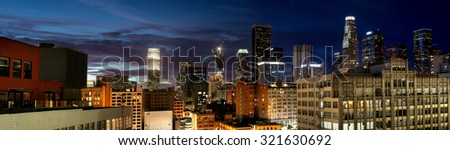 Historic Core and Financial District of Downtown Los Angeles during night. All building logos has been edited out. - stock photo