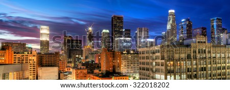 Historic Core and Financial District of Downtown Los Angeles on blue hour.  All building logos has been removed.  - stock photo