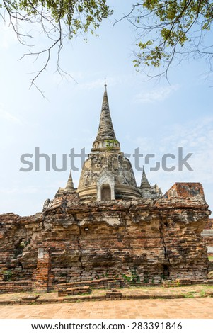 Historic destroyed temple in World Heritage city, Ayuddhaya, old brick pagoda and Buddhism church under blue bright sky in summer, Thailand