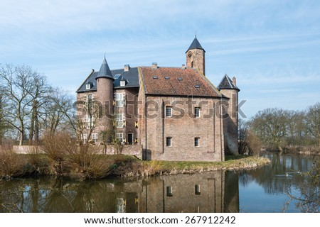 Historic Dutch castle with moat. It was built in 1627. It is early in the morning at the end of the winter season. - stock photo