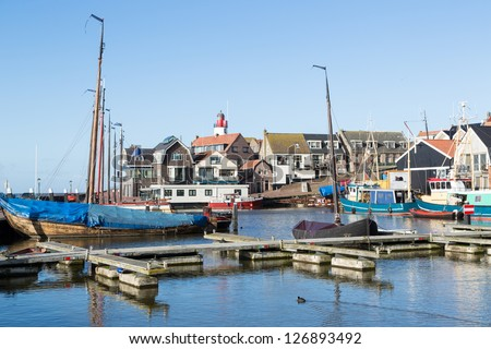 Historic Dutch harbor of Urk with lighthouse and old shipyard - stock photo