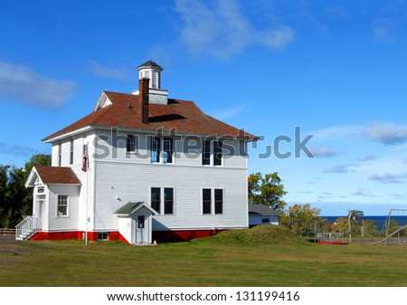 Historic Eagle River School House has been converted into a community center and museum.  Museum is located in Eagle River, Michigan. - stock photo
