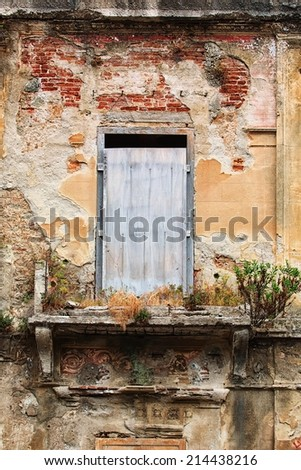 Historic house with balcony and plants in Italy - stock photo