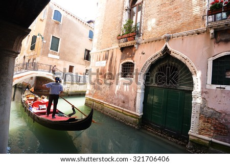 Historic houses, canals and lagoon in Venice - stock photo