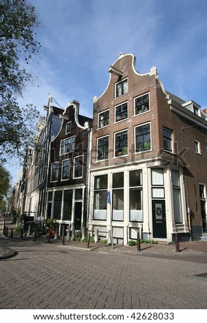 Historic houses in old Amsterdam on the corner of Brouwersgracht - stock photo