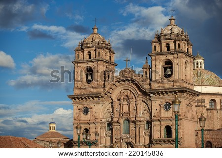 Historic Iglesia de la Compania in the Plaza de Armas of Cusco in Peru. The church dates back to 1571 and sits on top of an old Inca Palace. - stock photo