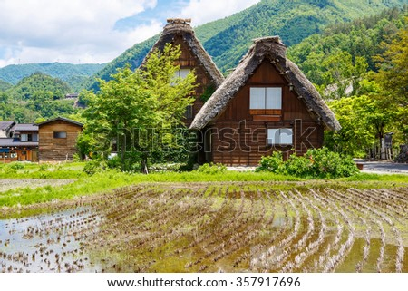 Historic Japanese village Shirakawa-go located in Gifu Prefecture. Traditional village showcasing a building style known as gassho-zukuri. one of Japan's UNESCO World Heritage Sites in summer. - stock photo