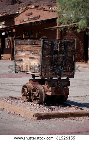 Historic mining cart in old ghost town - stock photo