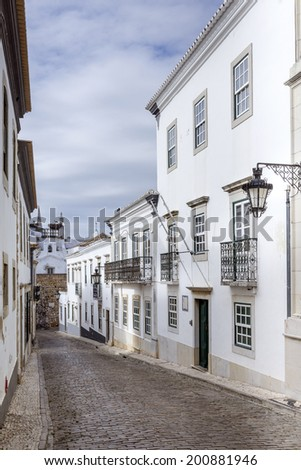 Historic, old district in Faro, Algarve (Portugal) during cloudy day - stock photo