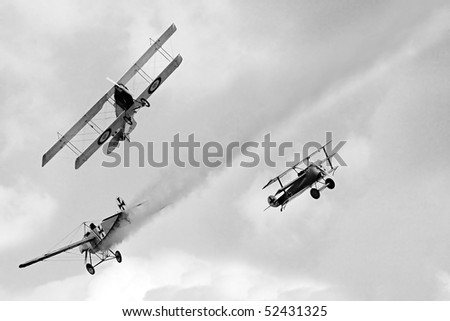 Historic planes dogfight on the sky.Vintage style photography. WW1 scene. All planes are homemade radio control models. - stock photo