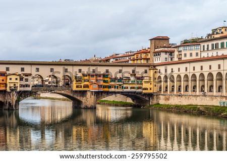 historic Ponte Vecchio over Arno river in Florence, Italy. - stock photo