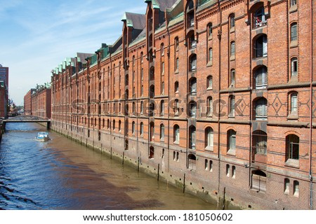 Historic red brick storage facilities in the Speicherstadt harbor area of Hamburg, Germany. - stock photo